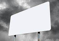Large white blank sign with cloudy sky.
