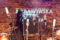 Microphones with a brick stage background