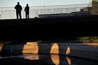 A footbridge over the River Manzanares, at dusk. Madrid, Spain