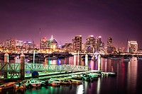Night scene of lights at a boat dock and the San Diego Downtown Skyline. San Diego, California, United States.