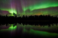 Northern lights reflecting in a lake, Lapland