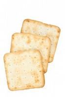 Three cream crackers on a white background