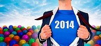 Businessman opening his shirt superhero style against many colourful balloons against sky