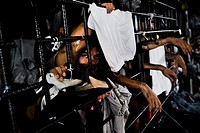 A Mara gang member looks through the bars in a cell at the detention center in San Salvador, El Salvador, 20 February 2014. Although the country´s two...