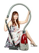 Girl in with vacuum cleaner