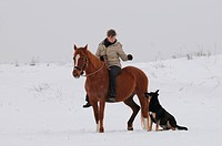 woman rides pony