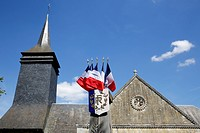 Church and French flags.