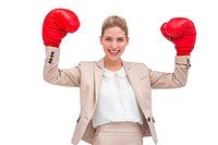 Smiling businesswoman with boxing gloves