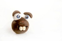 Funny toy face plasticine handmade on white