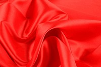 Close up of red silk fabric background.
