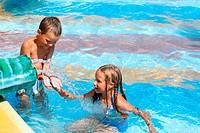 Children in summer outdoor pool.