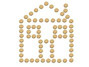 A house made of Australian one dollar coins isolated on white