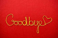 goodbye ribbon greeting and hearts on red background