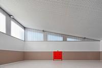 Gymnasium with red door. Center School S.Miguel de Nevogilde, Oporto, Portugal. Architect: AVA Architects, 2012.