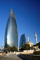 Azerbaijan, Baku, Martyrs´ Lane (Alley of Martyrs), small mosque and the Flame Towers.