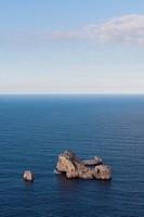 Small rock island in Mediterranean sea