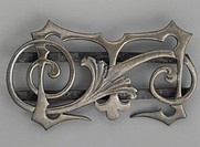 Silver alloy monogram buckle. 20th century.  Private Collection