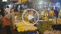 Woman seller of lotus flowers in Pak Khlong Talat , Flower market , Bangkok , Thailand. Pak Khlong Talat is a market in Bangkok, Thailand that sells f...