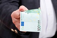 front view 100 euro banknote in businessman hand