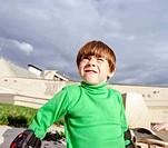 Little preschooler boy learning rollerskating
