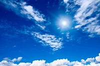White clouds with sun in sky