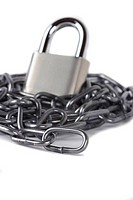 A black chain and padlock isolated against a white background