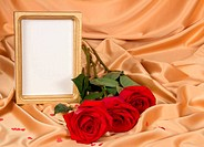 Empty photoframe with roses