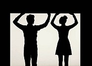 Strong couple holding the ceiling