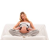 Young attractive pregnant woman isolated on white