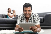 happy Indian man using Digital Tablet
