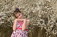 Girl with white flowers head on her hands