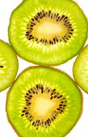 Background of two full and two quarters kiwi slices