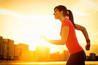 Woman running on summer sunset