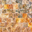 Decorative textured background wall of marble tiles