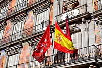 Detail of a decorated facade and balconies at the Palza Mayor, Madrid, Spain.