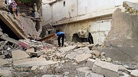 (150707) -- FALLUJAH, July 7, 2015 () -- A man inspects a destroyed building after an airstrike by the Iraqi Air Force in Islamic State (IS) militants...