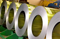rolls of steel sheet inside of plant.