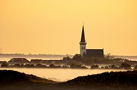 The church and village of Den Hoorn on Texel Island rising above morning mist, or inversion fog