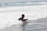 Girl goes for a drive on waves on bodysurf in Indian ocean