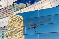 Germany, Duesseldorf, reflections of construction crane and buildings on glass facade of Koe-Bogen