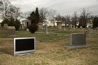 Television in graveyard.