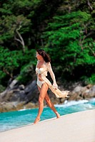 Sexy Slim woman walking at beach