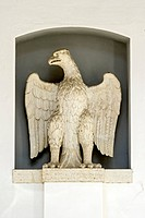 Stone imperial eagle next to the portal of the Heilig-Geist-Spital hospital, Augsburg, Swabia, Bavaria, Germany