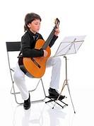 Little boy musician playing guitar