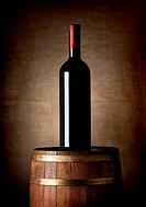 Bottle of wine on an old barrel