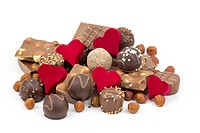 delicious chocolate and hearts on white background