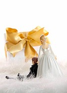 Wedding cake figures with gift on white