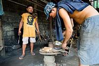 Blacksmiths at work in Puerto Princesa, Palawan, Philippines.