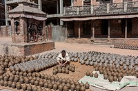 Bhaktapur, Nepal. Potter at Work in Potters´ Square.