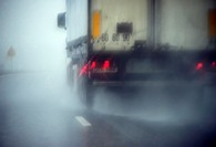 Europe, Germany, Bavaria, truck on a highway in heavy rain
